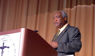 Rep. Danny Davis (D-7-IL) addresses attendees at a legislative breakfast arranged by Eye on Washington.